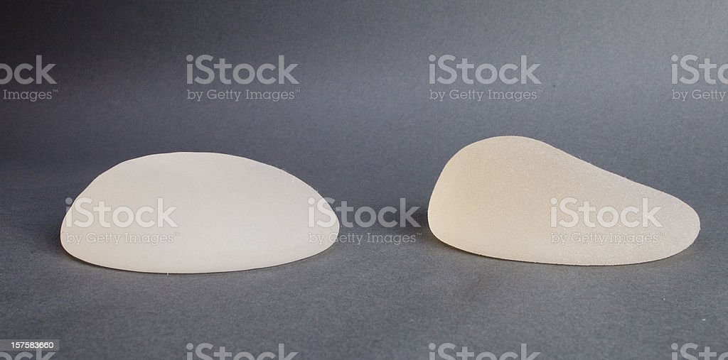 Close-up of lopsided breast implants on a table stock photo