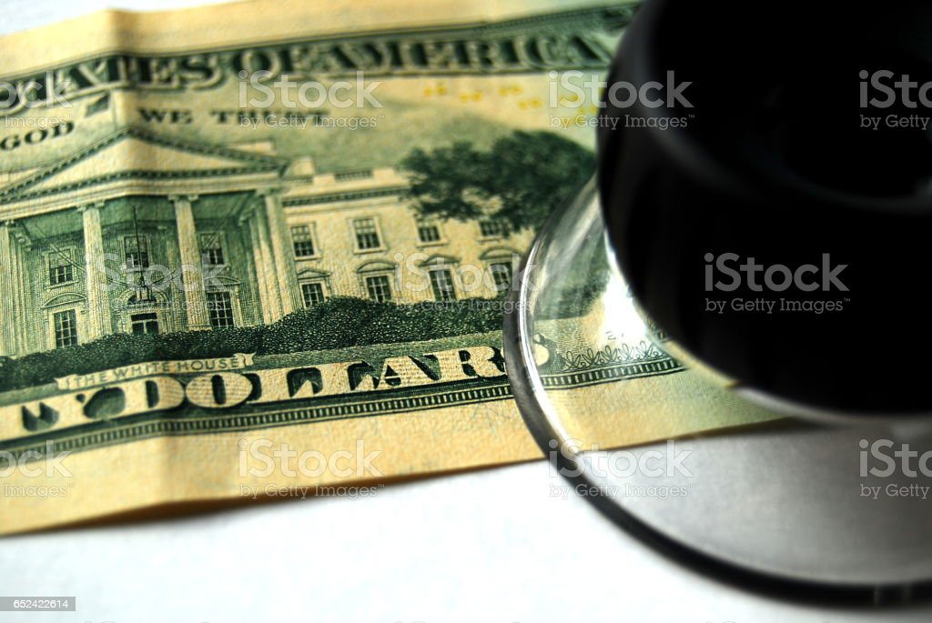 Close-Up of Loupe and Back of U.S. Twenty-Dollar Bill stock photo