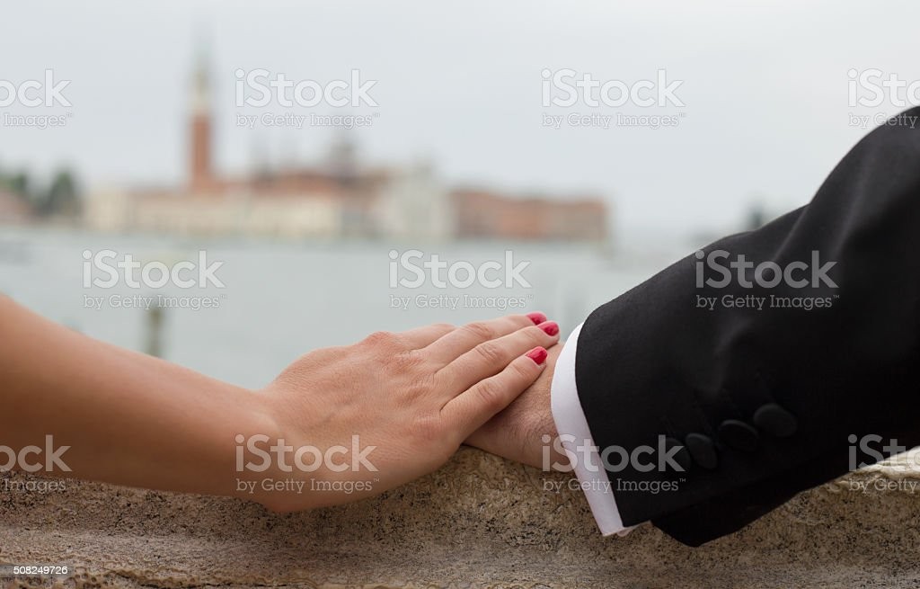 Close-up of lover's hands stock photo
