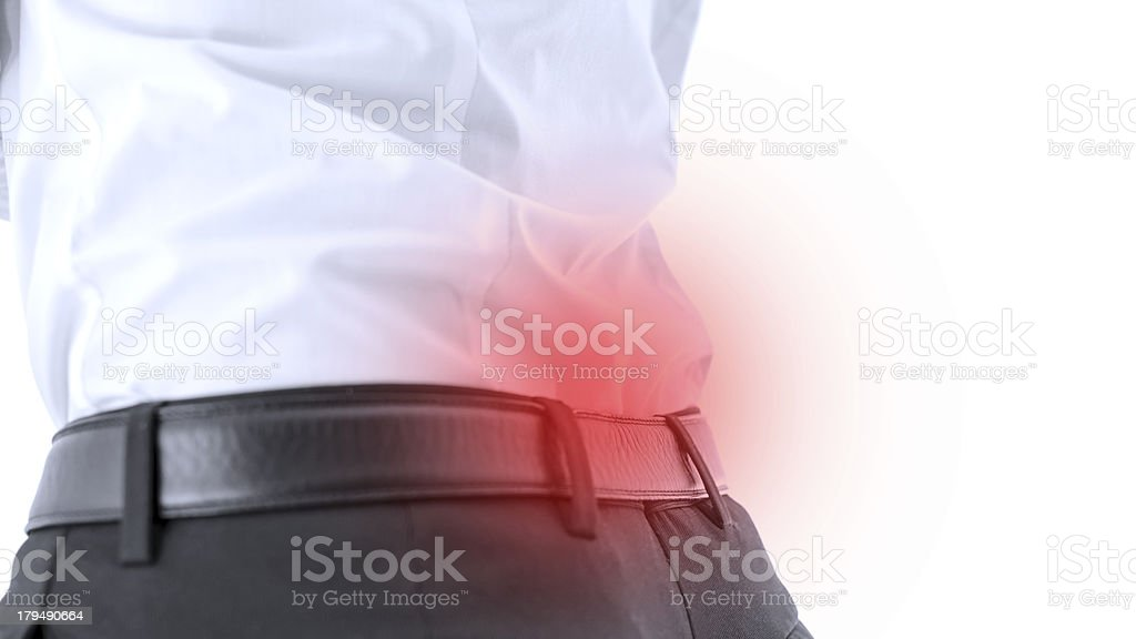 Closeup of lower back pain stock photo
