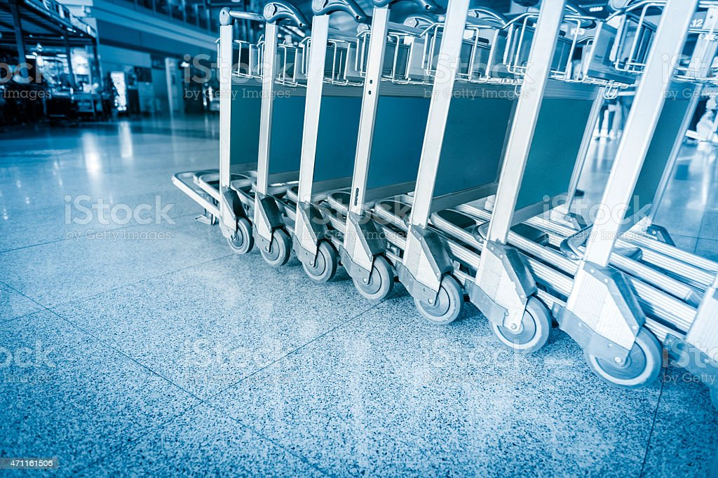 Close-Up Of Luggage Trolley's Wheel stock photo