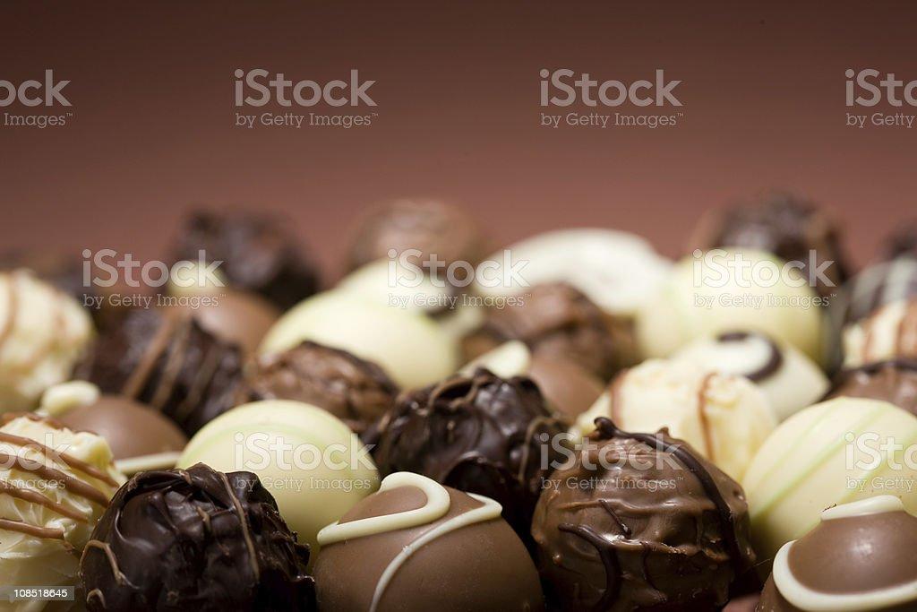 Close-up of luscious dark, white and milk chocolates stock photo