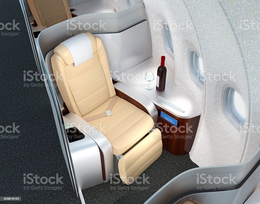 Close-up of luxurious business class seat with metallic silver partition. stock photo