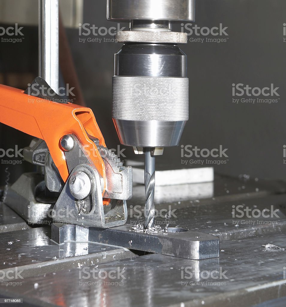 Close-up of machine drilling metal stock photo