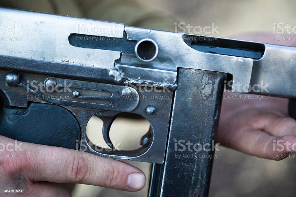 closeup of machine gun trigger guard and magazine stock photo