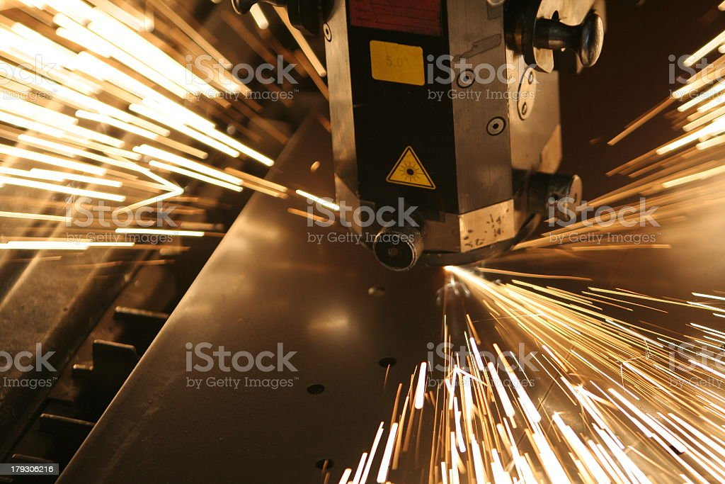 Close-up of machinery working on metal with sparks flying royalty-free stock photo