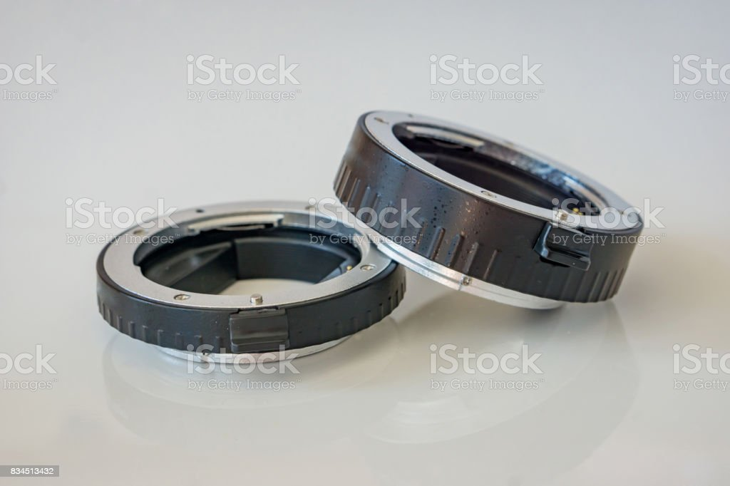Close-up of macro rings, white background, copy space. Shallow depth of focus. Concept Technology. stock photo