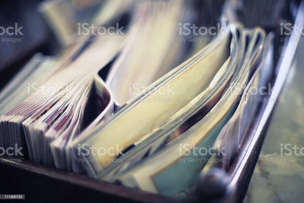 Close-up of magazines stacked in a magazine-holder stock photo