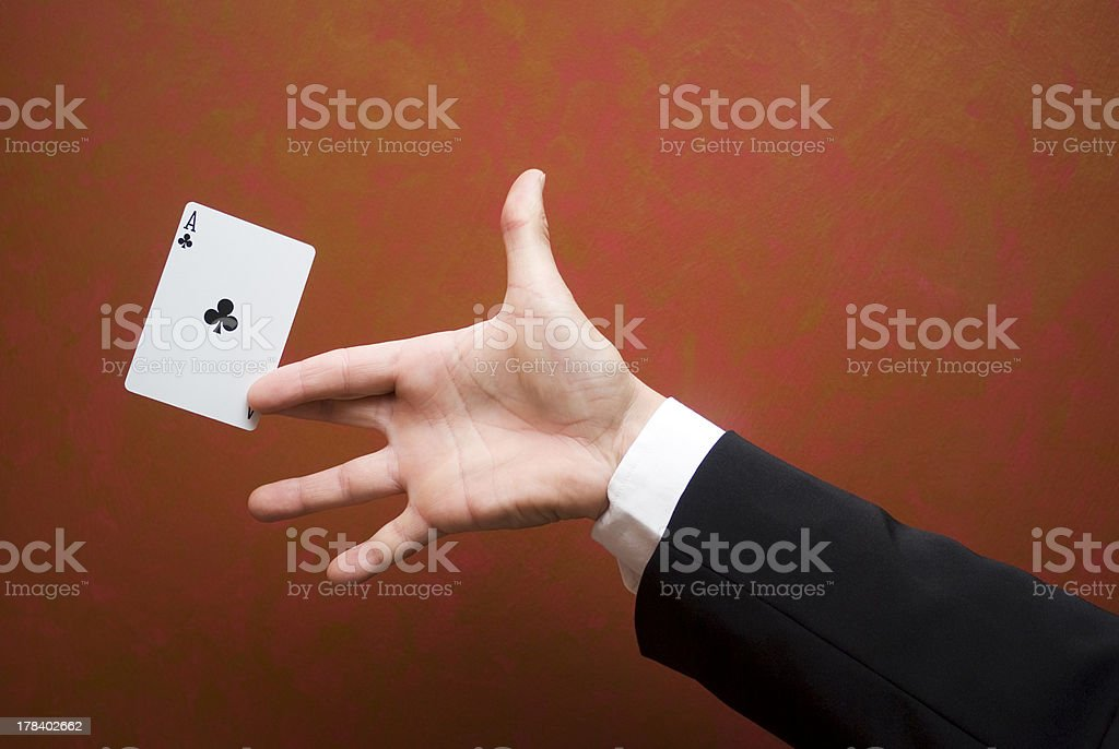 Close-up of magician performing trick with ace card stock photo
