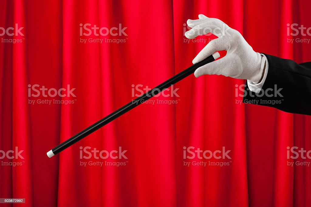 Close-up Of Magician With The Magic Wand stock photo
