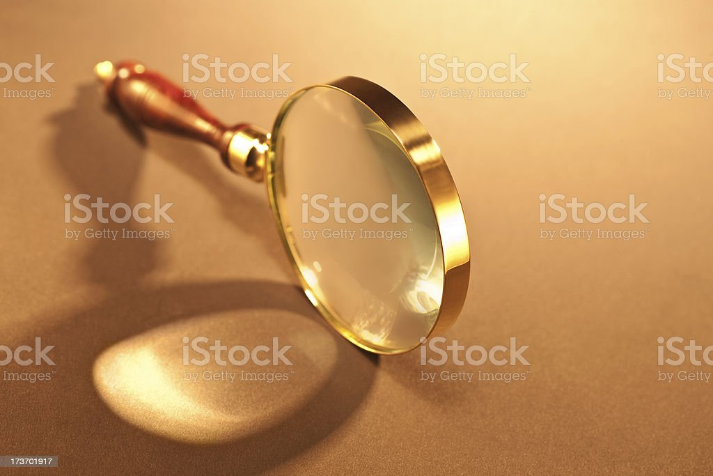 Closeup of magnifying glass stock photo