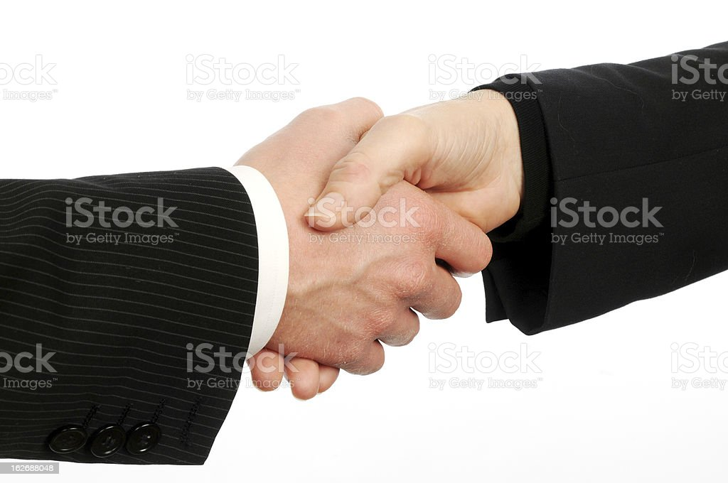 closeup of male and female executives shake hands on deal royalty-free stock photo