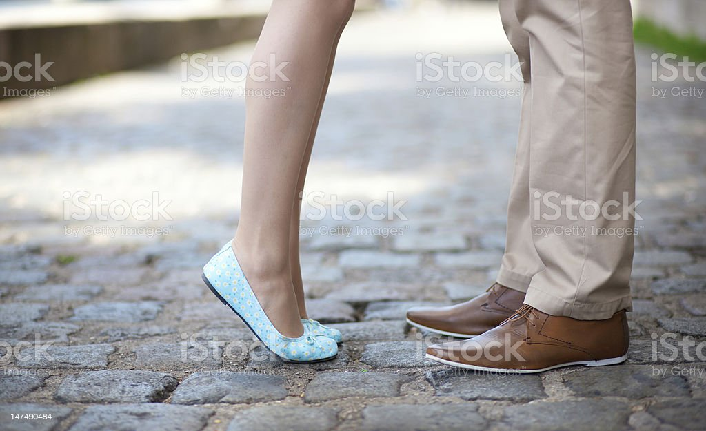 Closeup of male and female legs during a date royalty-free stock photo