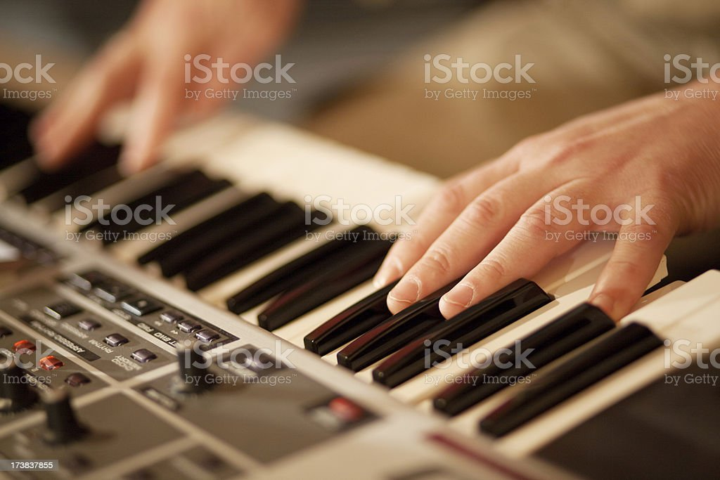 Close-up of male hands playing an electric keyboard stock photo
