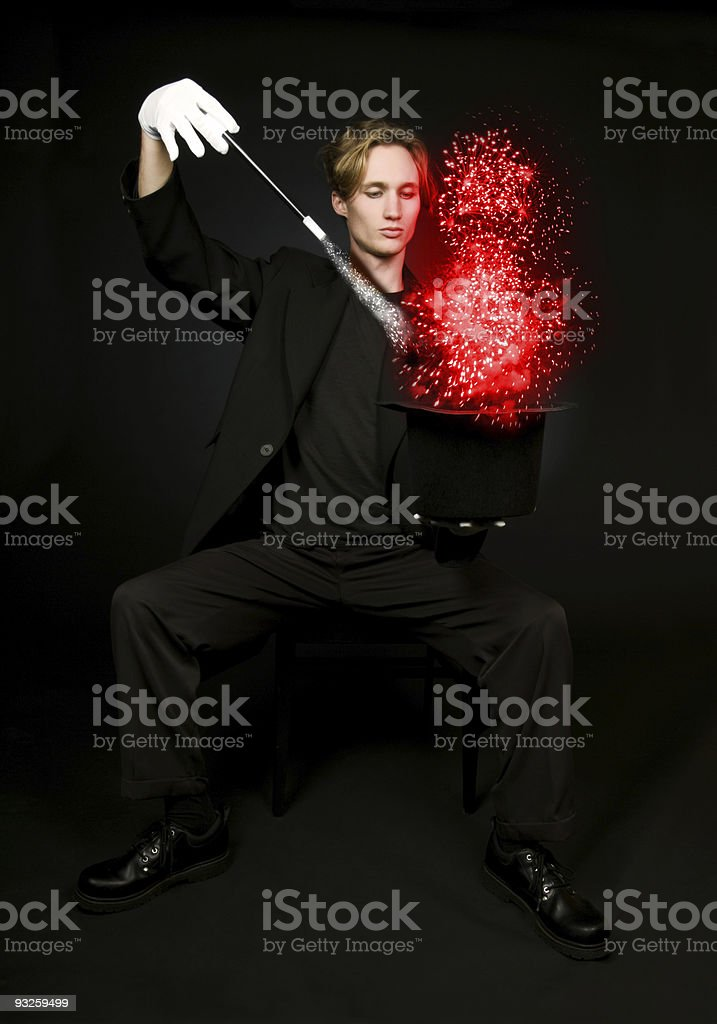 Close-up of male magician performing magic show royalty-free stock photo