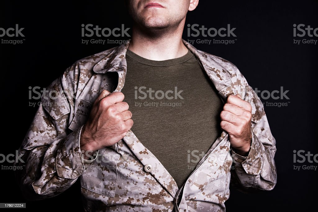 Close-up of male opening clothes and showing marine uniform stock photo