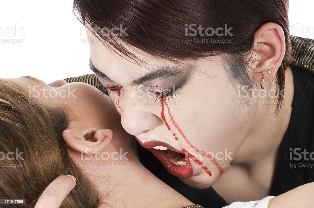 Closeup of male vampire about to bite victim. royalty-free stock photo
