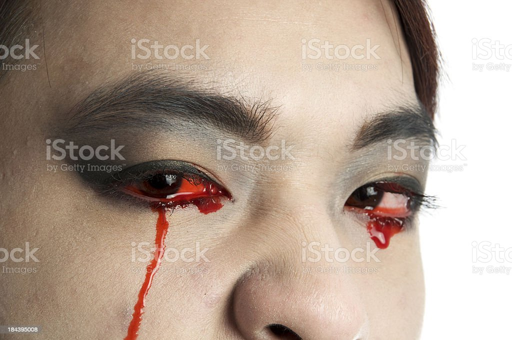 Closeup of male vampire crying blood. royalty-free stock photo