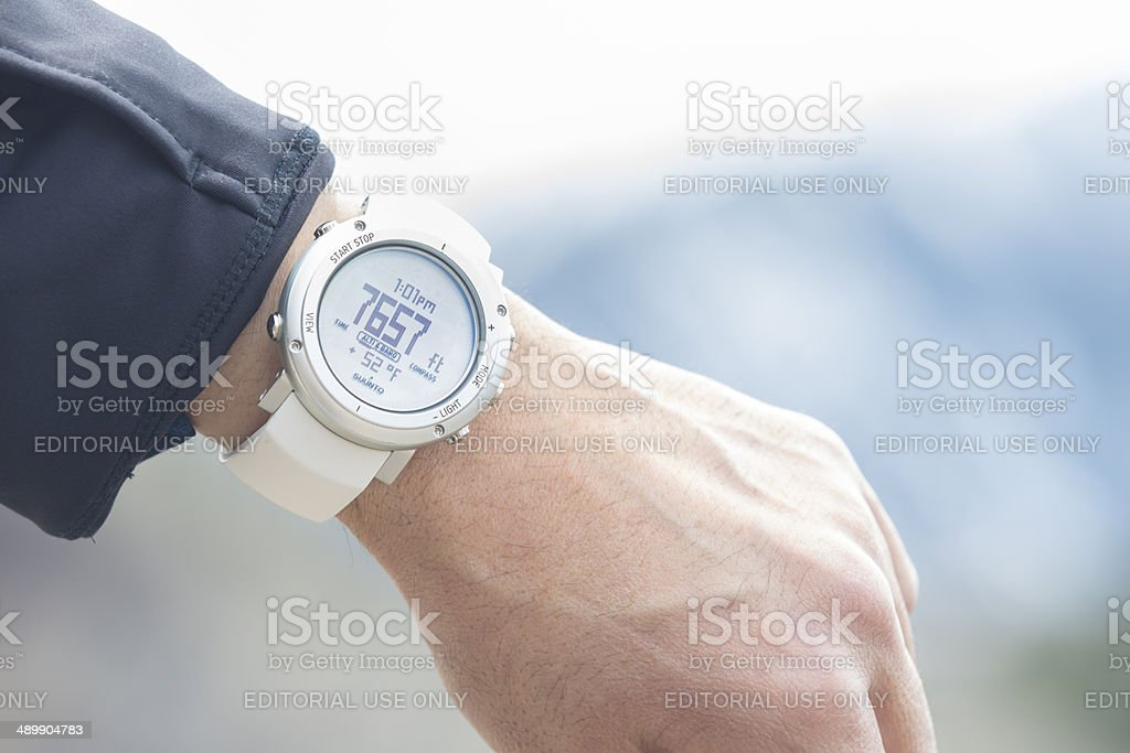 Closeup of man checking his current altitude on Suunto watch royalty-free stock photo