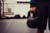 Close-up of man holding heavy kettlebell