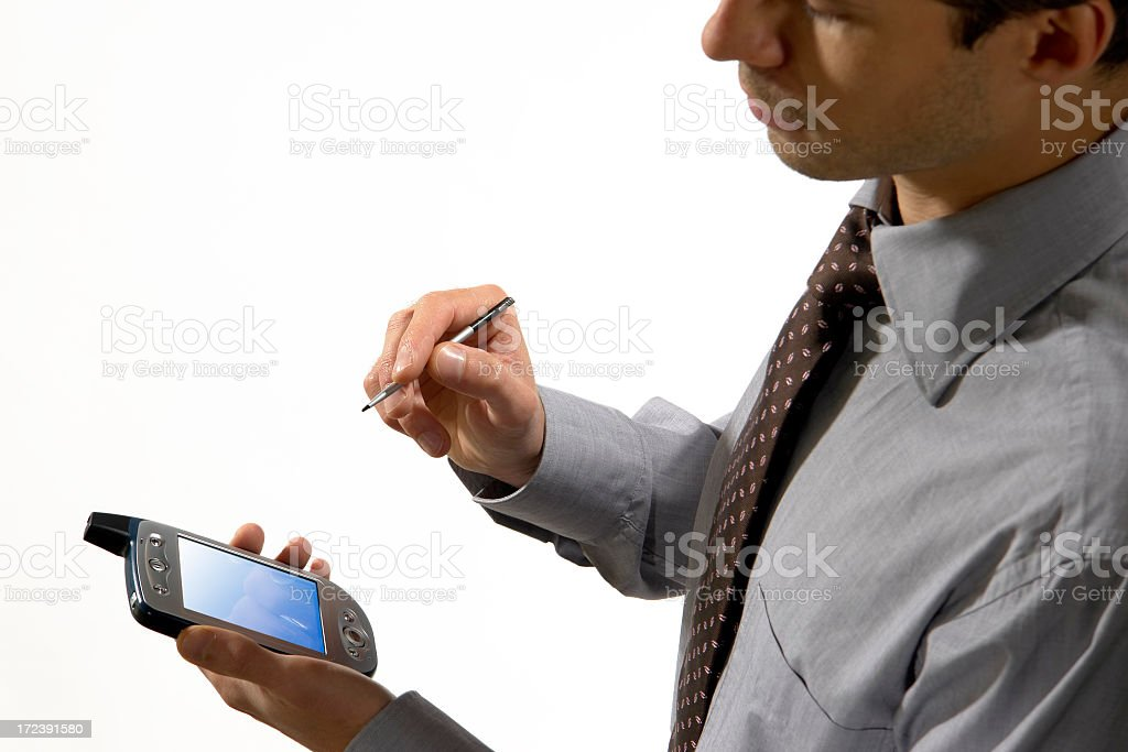 Close-up of man holding in hands mobile phone with scriber royalty-free stock photo