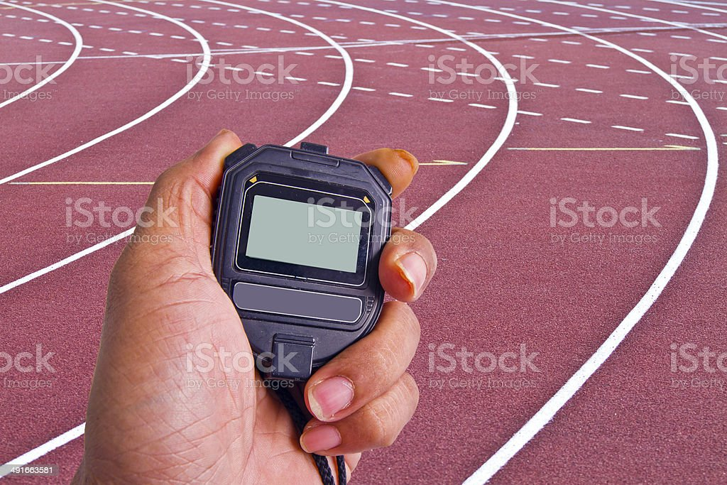 Close-up of  man holding  stopwatch to measure performances of t stock photo