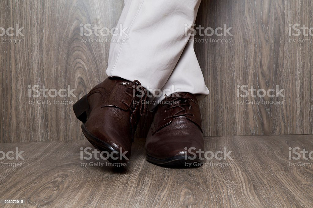 Close-up of man wearing brown leather shoes stock photo