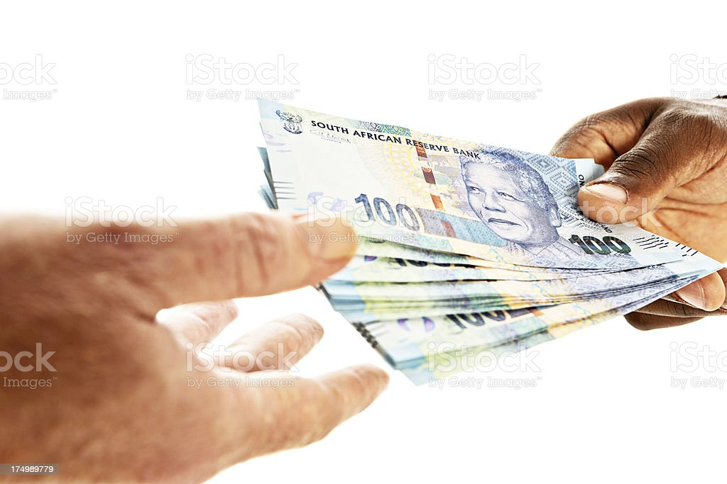Close-up of Mandela money being passed to male hand stock photo