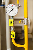 Closeup of manometer, pipes and faucet valves  gas heating system