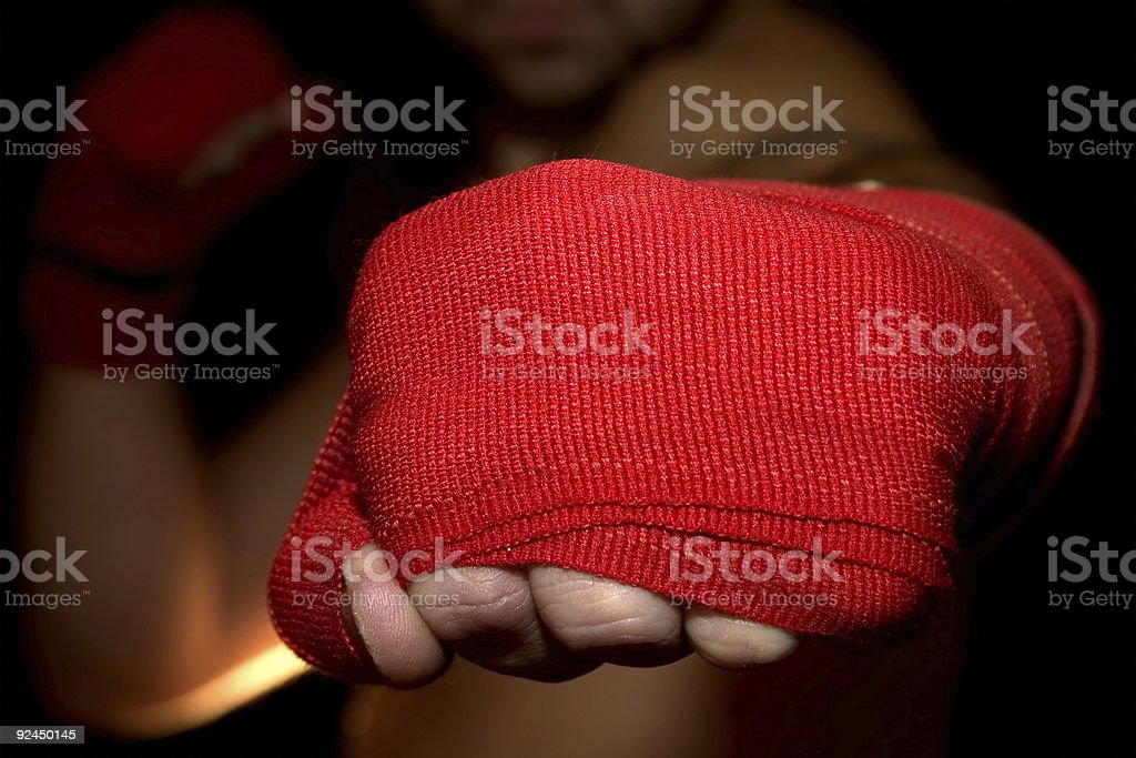 Close-Up of Man's Fist Punching Camera - POV royalty-free stock photo