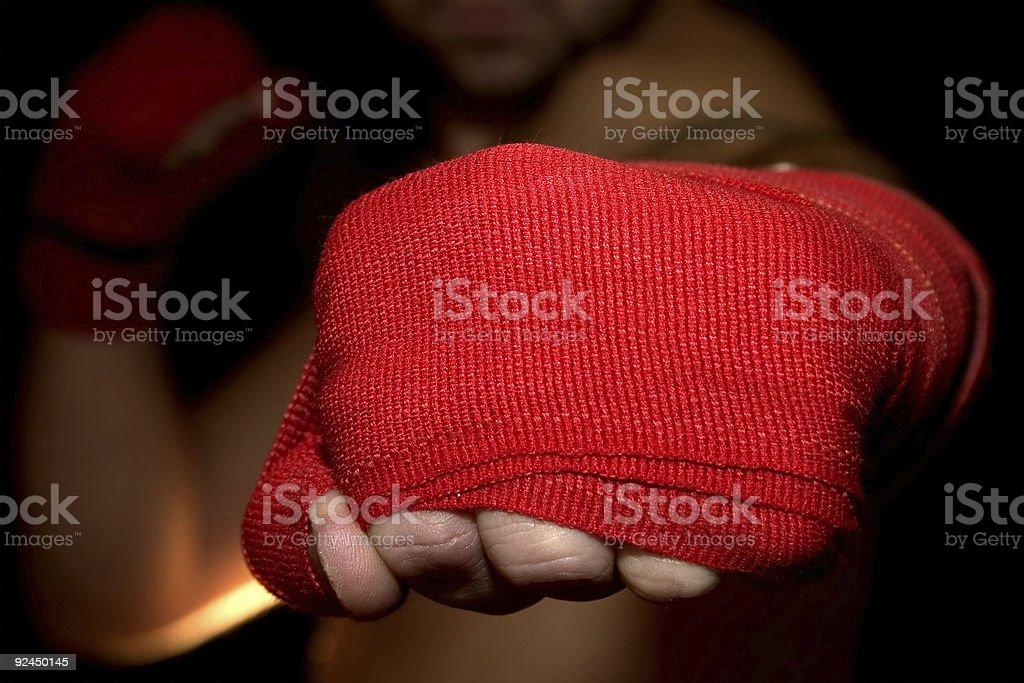 Close-Up of Man's Fist Punching Camera - POV stock photo