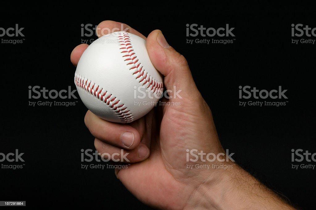 Close-up of man's hand griping a baseball stock photo