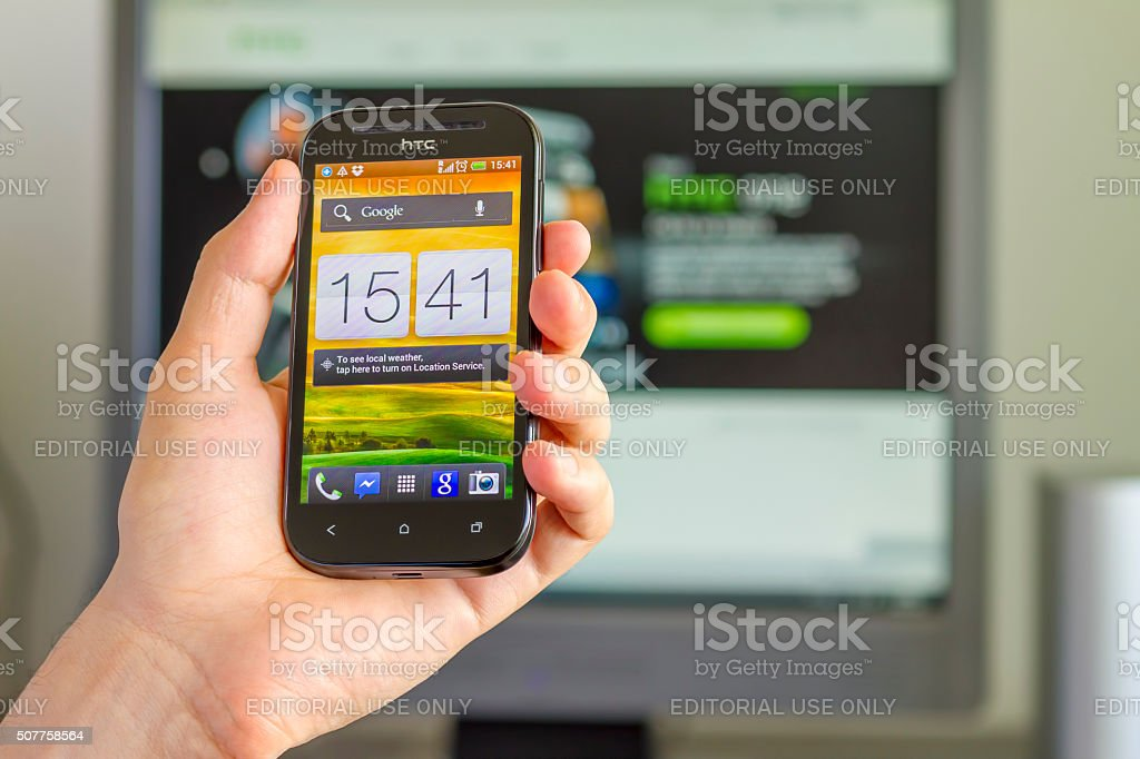 Closeup of Man's Hand holding a Smartphone in Office stock photo