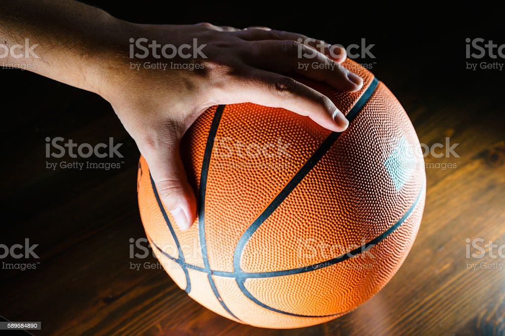 Close-up of man's hand over basketball stock photo
