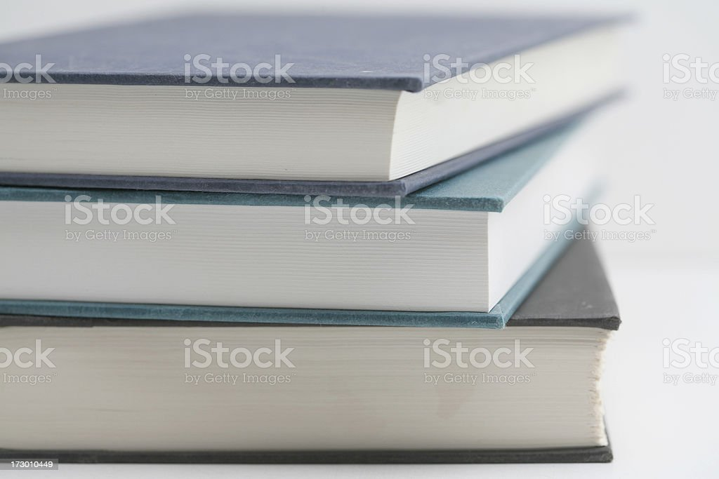 Closeup of many books stacked on top of each other. royalty-free stock photo