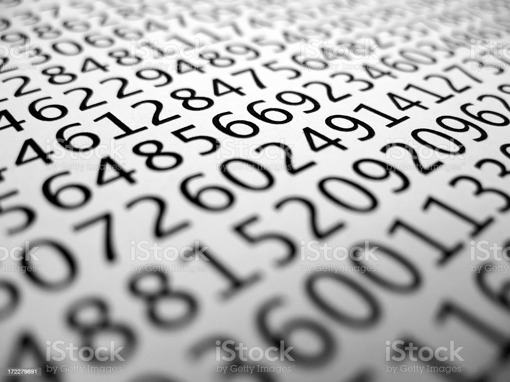Closeup of many various numbers in black on white background royalty-free stock photo