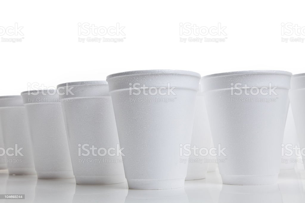 Closeup of many white Styrofoam cups on white background royalty-free stock photo