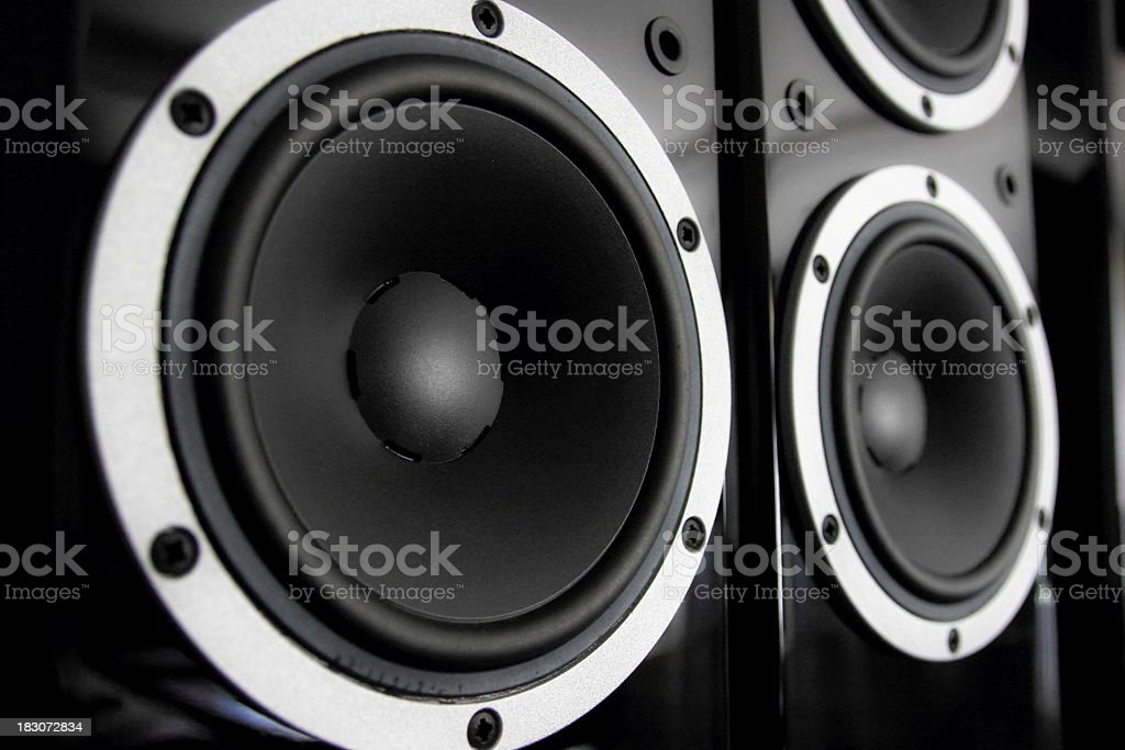 A close-up of matte black speakers stock photo