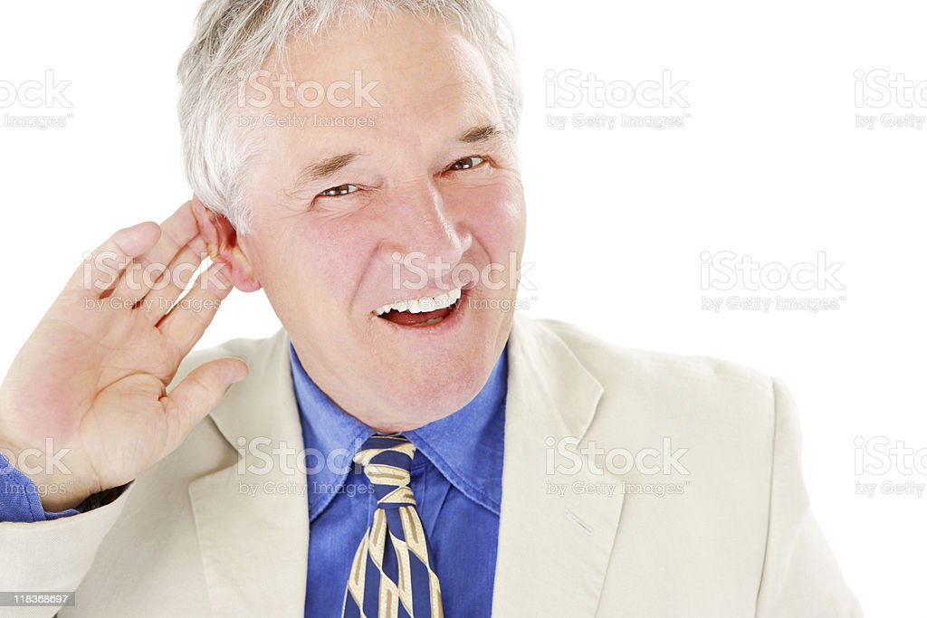 closeup of mature businessman holding his ear on white background royalty-free stock photo