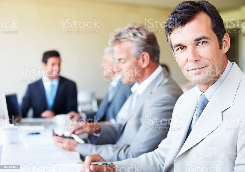 Close-up of mature businessman with his colleagues royalty-free stock photo