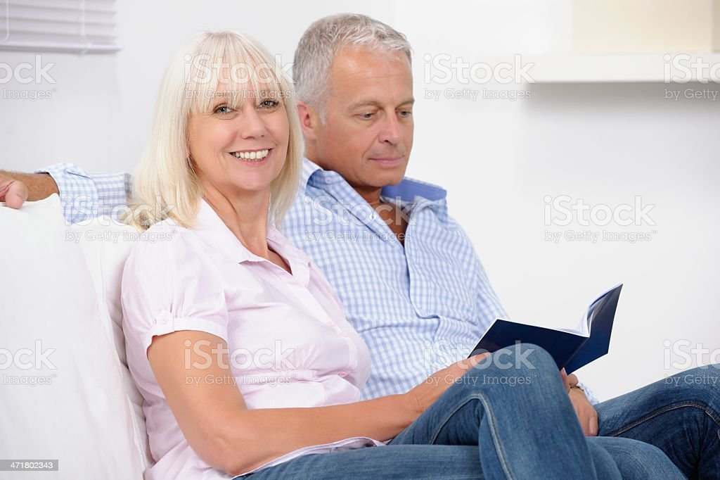 Close-up Of Mature Caucasian Couple Looking At A Brochure stock photo