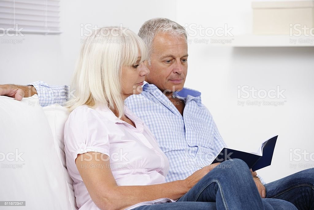 Close-up Of Mature Caucasian Couple Reading A Brochure stock photo