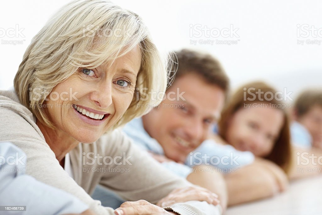 Close-up of mature woman smiling with family members royalty-free stock photo