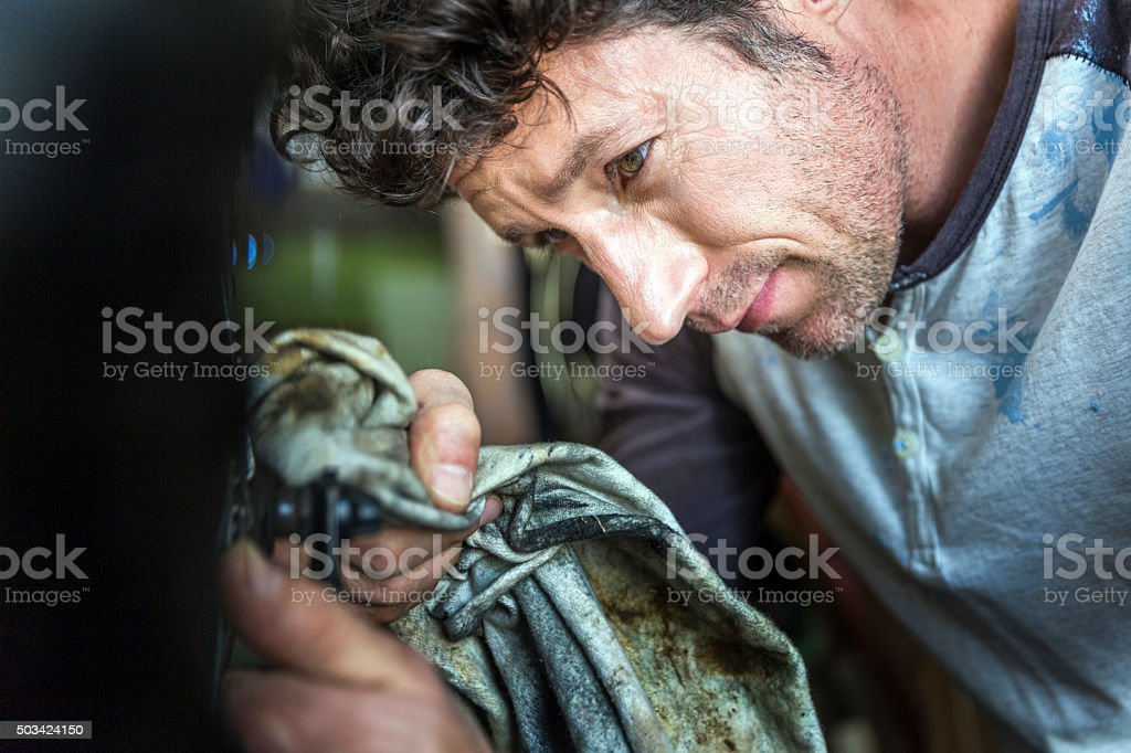 Close-up of mature worker cleaning cycle stock photo
