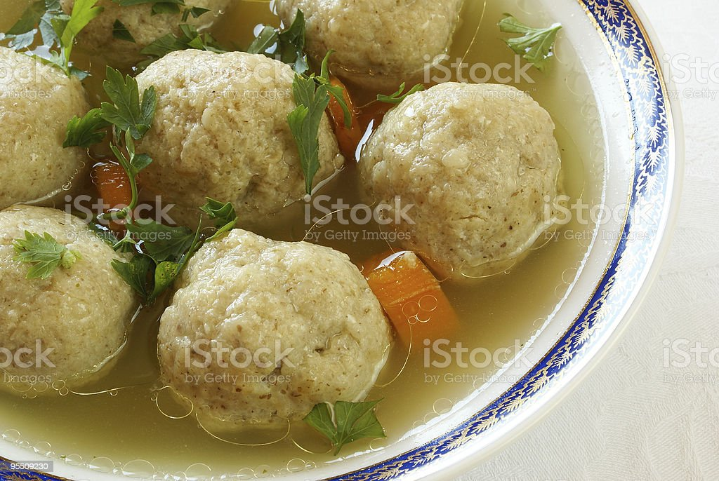 Close-up of Matzo ball soup decorated with herbs and carrots stock photo