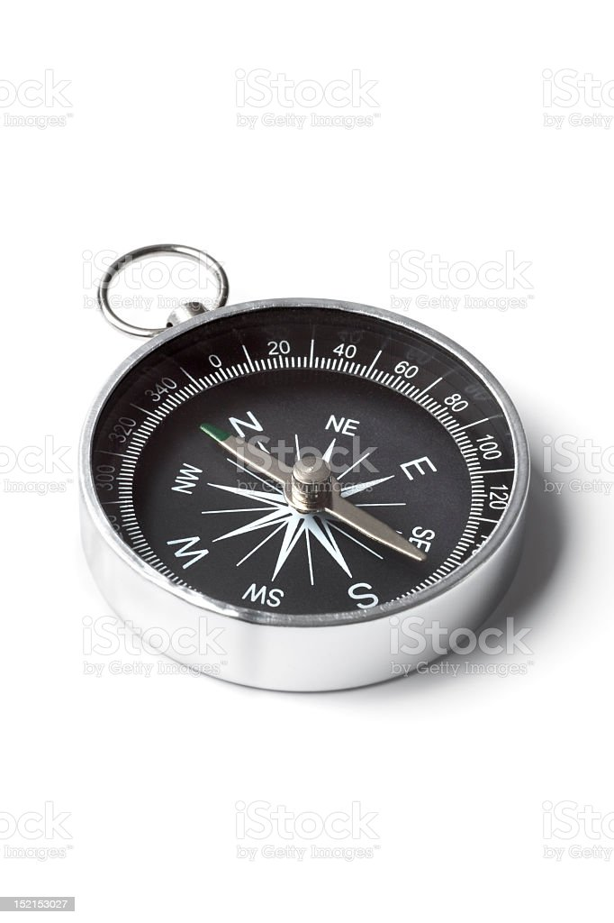 Close-up of metal pocket compass in white background stock photo