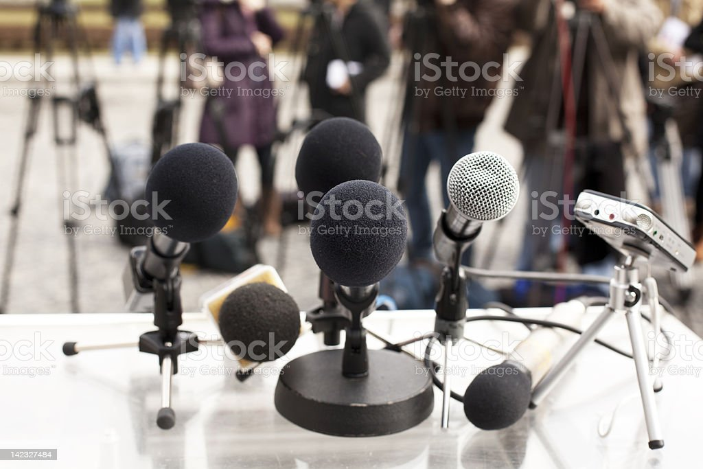Close-up of microphones at a press conference royalty-free stock photo
