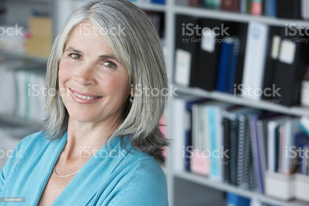 Closeup Of Middle Aged Businesswoman Smiling stock photo