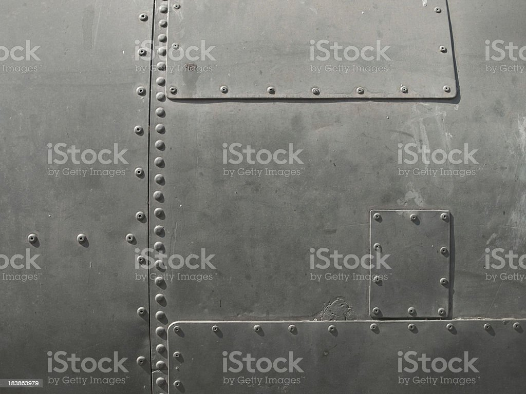 Close-up of military detail in a dark gray color stock photo