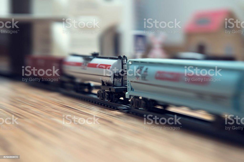 Close-up of miniature speeding freight train, motion blur stock photo